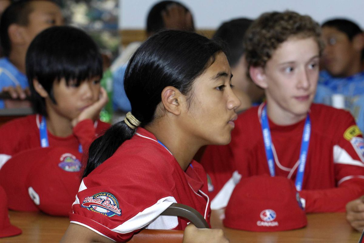 Katie Reyes listens as baseball Hall of Famer Jim Rice talks about hitting and sportsmanship Friday, August 21, 2009 in Williamsport, Pa. Reyes plays first base and center field for Hastings Community Little League representing Canada in the Little League World Series in Williamsport, Pa.