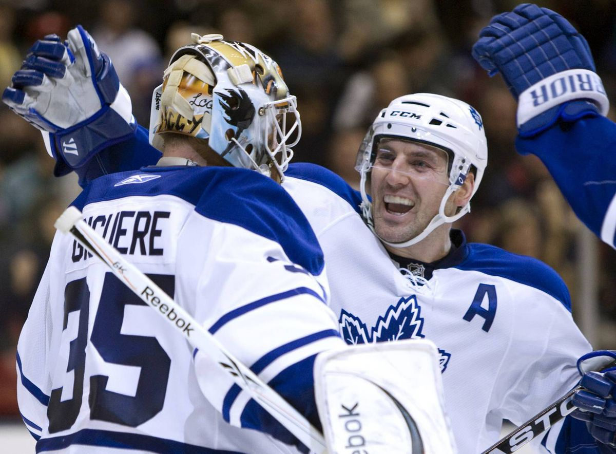 Toronto Maple Leafs goaltender Jean-Sebastien Giguere (left) is congratulated on his shutout performance by defenceman Francois Beachemin after defeating the Ottawa Senators 5-0 in NHL hockey action in Toronto on Saturday February 6, 2010.THE CANADIAN PRESS/Frank Gunn