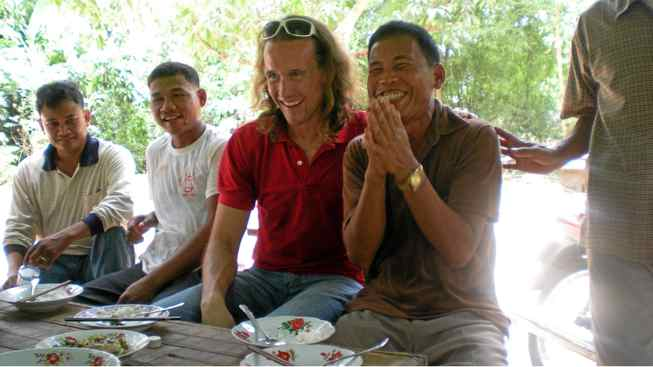 Winnipeg entrepreneur Cordell Jacks with villagers in Cambodia.