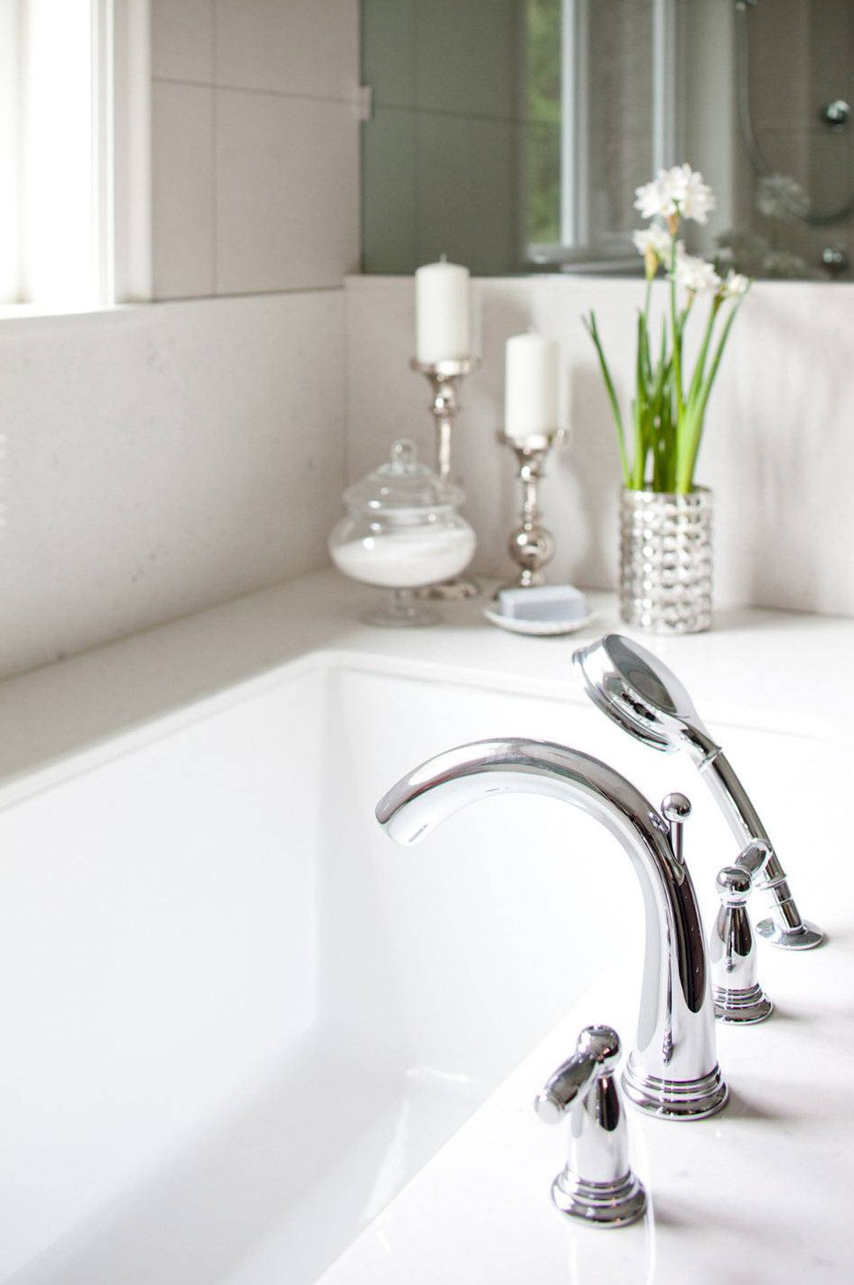 The room design is fairly modern in an otherwise traditionally-styled home. As a counterbalance, traditional faucets and hardware were chosen.