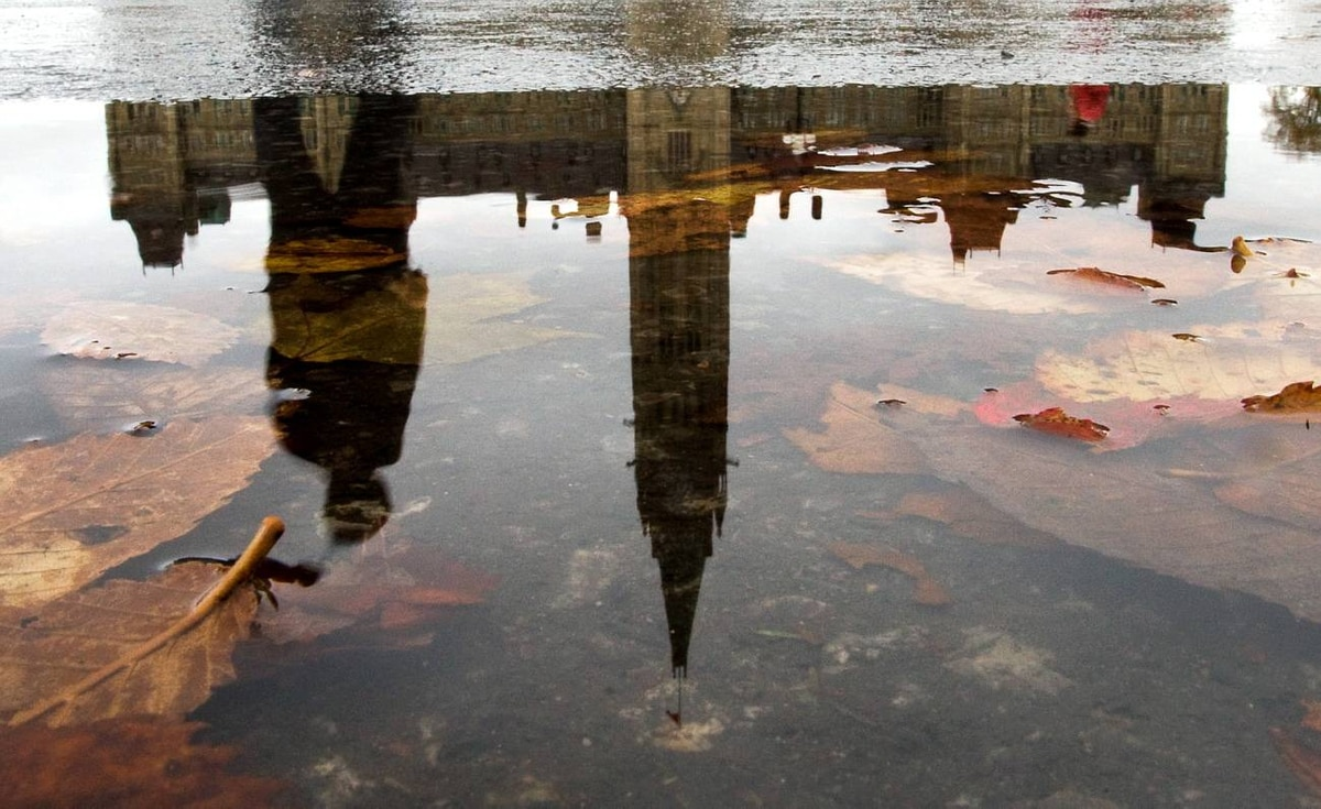 The Peace Tower is reflected in a puddle as overcast skies and rain greeted visitors to Parliament Hill in Ottawa, Tuesday October 13, 2009.