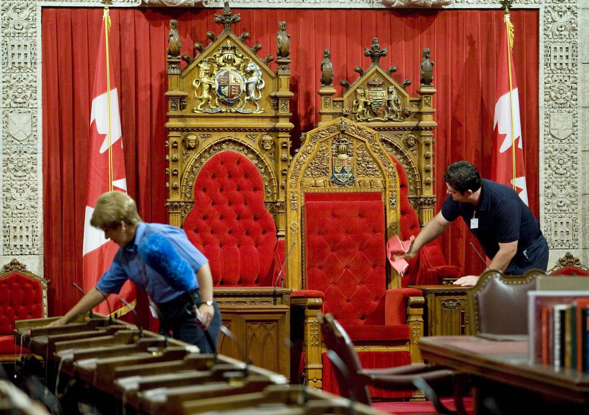 Cleaning staff prepare the Senate for the next session, which begins Sept. 14 amid heightened threat of a snap election.