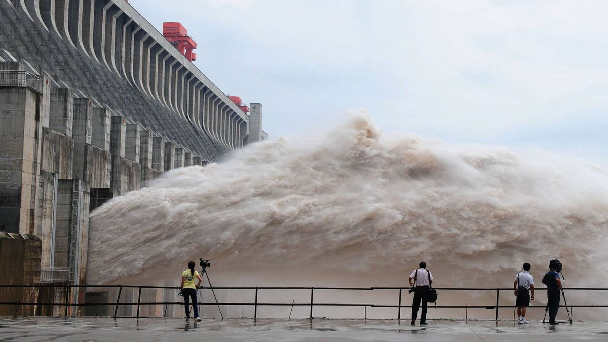 Journalists take photos as flood water is released from the Three Gorges Dam's floodgates in Yichang, in central China's Hubei province.