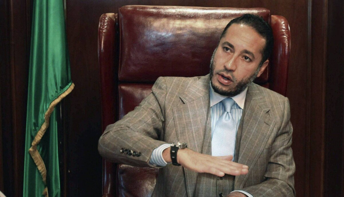 "Saadi Gadhafi, son of Libyan leader Muammar Gadhafi, speaks during a news conference at his office in Tripoli in this January 31, 2010 file photo. Saadi Gaddafi fled to Niger and is thought to still be there. He is a former soccer player who had a brief career playing professional soccer in Italy. Saadi's lawyer said he was ""shocked and outraged by the vicious brutality which accompanied the murders of his father and brother."""