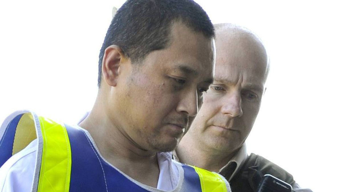 Vince Li is escorted by sheriff officers on his way to a court appearance in Portage la Prairie, Man., on Aug. 5, 2008.