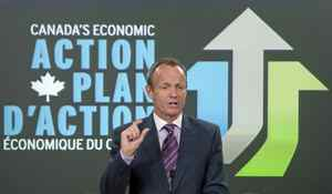 Treasury Board President Stockwell Day announces cuts to federal agencies during a news conference in Ottawa on Monday, March 8, 2010.