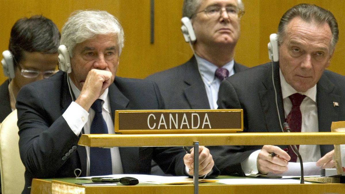 Foreign Affairs Minister Lawrence Cannon and junior minister Peter Kent react after Canada was forced into a run-off vote against Portugal at United Nations headquarters in New York on Oct. 12, 2010.