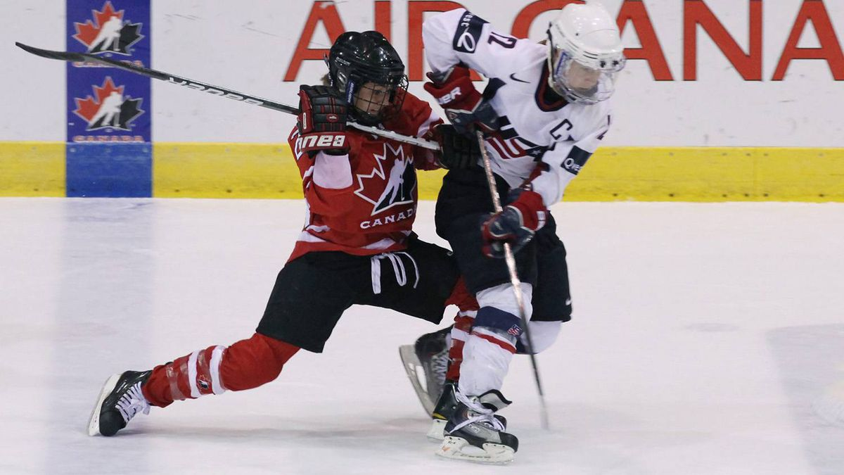 Vicki Bendus of Team Canada and Jenny Potter of Team USA chase the puck during third period round robin play at the Four Nations Cup in St. John's on Tuesday, Nov. 9, 2010.