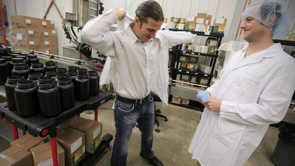 Manitoba Harvest Hemp Foods co-founder and CEO Mike Fata, left, with Tom Greaves, director of operations, overseeingproduction at the company's facility in Winnipeg.