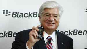 """Mike Lazaridis, President and Co-CEO of Research In Motion (RIM), poses with the new """"Blackberry Bold 9700"""" handset during its launch in October."""