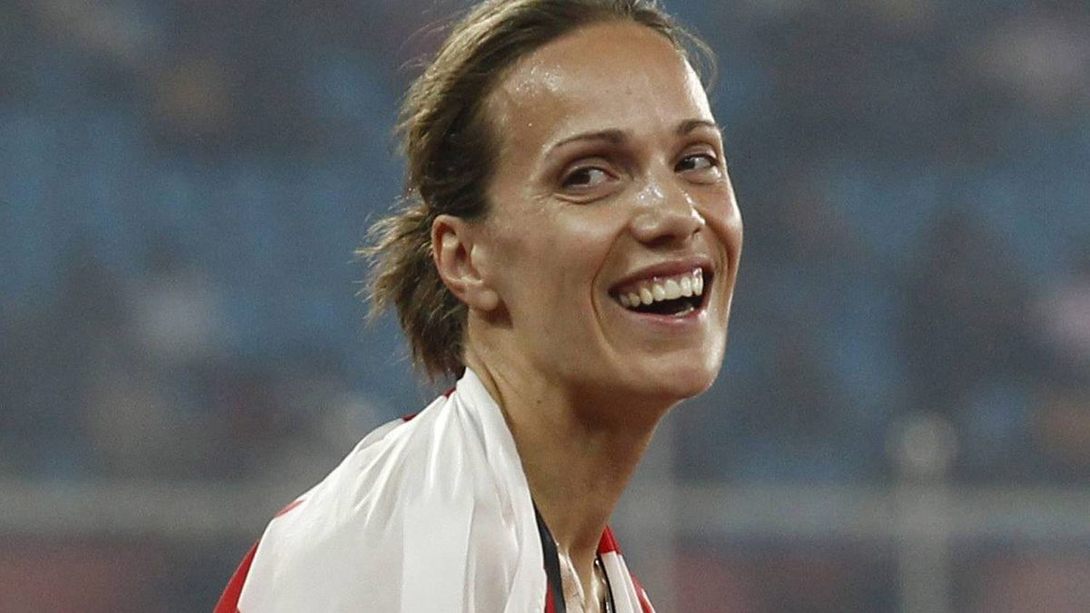 Canada's Jessica Zelinka reacts after winning gold in the Heptathlon during the Commonwealth Games at the Jawaharlal Nehru Stadium in New Delhi, India, Saturday, Oct. 9, 2010. (AP Photo/Anja Niedringhaus)