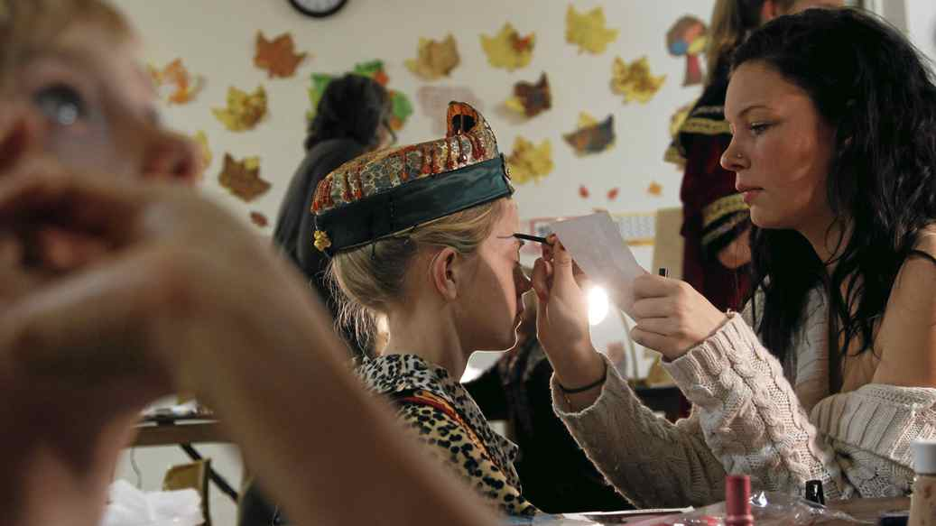 """Nyla White, 16, (right) used to perform in the pageant when she was younger, but for the past four years, she's done the makeup for the actors. """"You look so cool,"""" she tells Sarah Skeat (centre), 12, who plays the second of three kings. Sarah has performed in the pageant for seven years, playing various roles from David to an angel choir member to a Bethlehem girl to a gift-bearer. By now, she's given up on looking for her parents in the audience. """"The lights are too bright. I can't really see anything."""""""