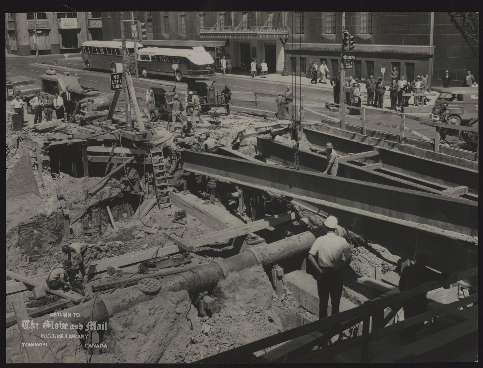 T.T.C. University Subway Nearing Union Station---One of the last stages of excavation work on the University Ave. subway is nearing completion at York and Front Sts. Subway will join Yonge St. subway at Union Station. Estimated cost of University Ave. subway is $40,000,000.
