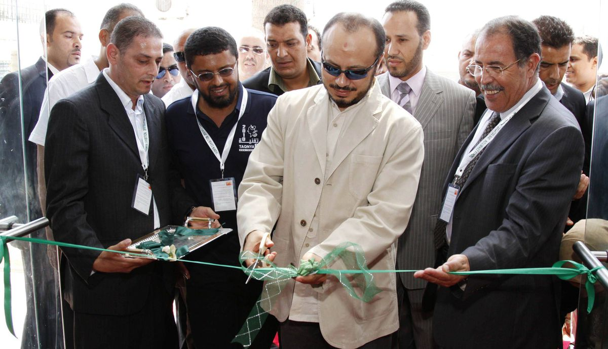 Mohammed, the son of Libyan leader Moammar Gadhafi, cuts the ribbon opening the Sixth Annual Telecommunications and Information Technology Expo in the Libyan capital Tripoli on July 20, 2010. Muhammad Gadhafi is the eldest son of Moammar Gadhafi and fled to Algeria in August after the fall of Tripoli. He was the head of Libya's Olympic committee and was heavily involved in the country's mobile and telecommunications sector.