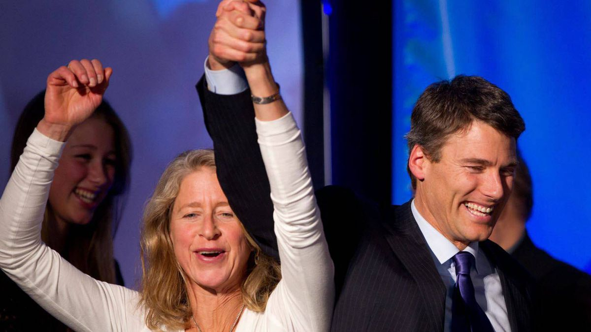 Vancouver Mayor Gregor Robertson, right, and his wife Amy celebrate after he was re-elected in a civic election in Vancouver, B.C., on Saturday November 19, 2011. Robertson was re-elected to a second term as mayor of Vancouver on Saturday, but the hold his Vision Vancouver party has had on city council has been reduced.