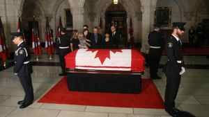 Mr. Layton's family pays their respects as he lies in state on Parliament Hill in Ottawa.