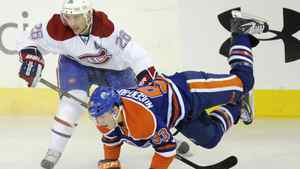Montreal Canadiens' Josh Gorges trips the Edmonton Oilers' Ryan Nugent-Hopkins in Edmonton on March 8, 2012.