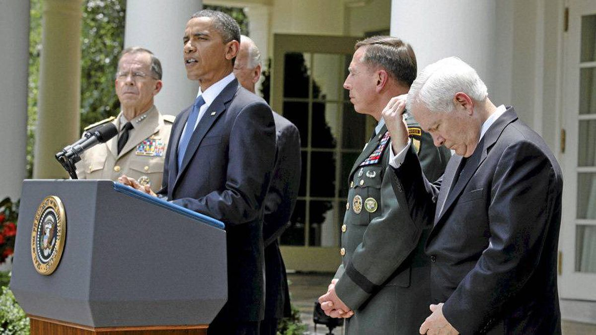 U.S. President Barack Obama announces the replacement of General Stanley McChrystal as top war commander in Afghanistan with General David Petraeus, second from right, in June.