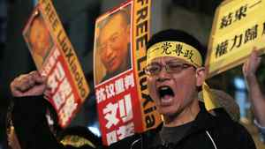 Pro-democracy protesters hold the picture of Chinese dissident Liu Xiaobo during a demonstration outside the China's Liaison Office in Hong Kong Friday, Oct. 8, 2010. Imprisoned Chinese dissident Liu Xiaobo won the 2010 Nobel Peace Prize on Friday for using non-violence to demand fundamental human rights in his homeland.