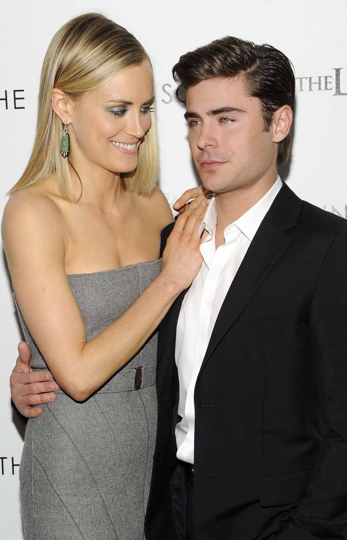 "Actress Taylor Schilling gently tries to nudge co-star Zac Efron out of an insulin coma after a screening of ""The Lucky One"" in New York last week."