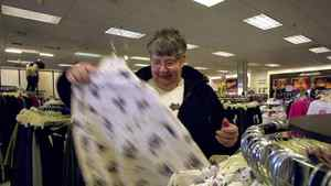 FILE--Ruth Wilson shops for clothes at Fashion Bug Plus in Bristol, Pa. Thursday, Jan. 25, 2001. Charming Shoppes, which runs 1,789 stores in 48 states has been purchased by Ascena Retail Group.