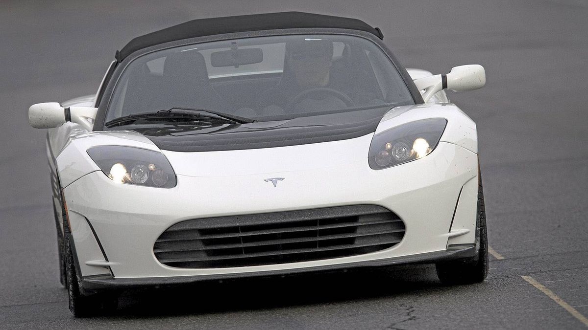 Peter Cheney drives the Tesla Roadster, an electrically charged sports car January 24, 2011. (Moe Doiron/The Globe and Mail)