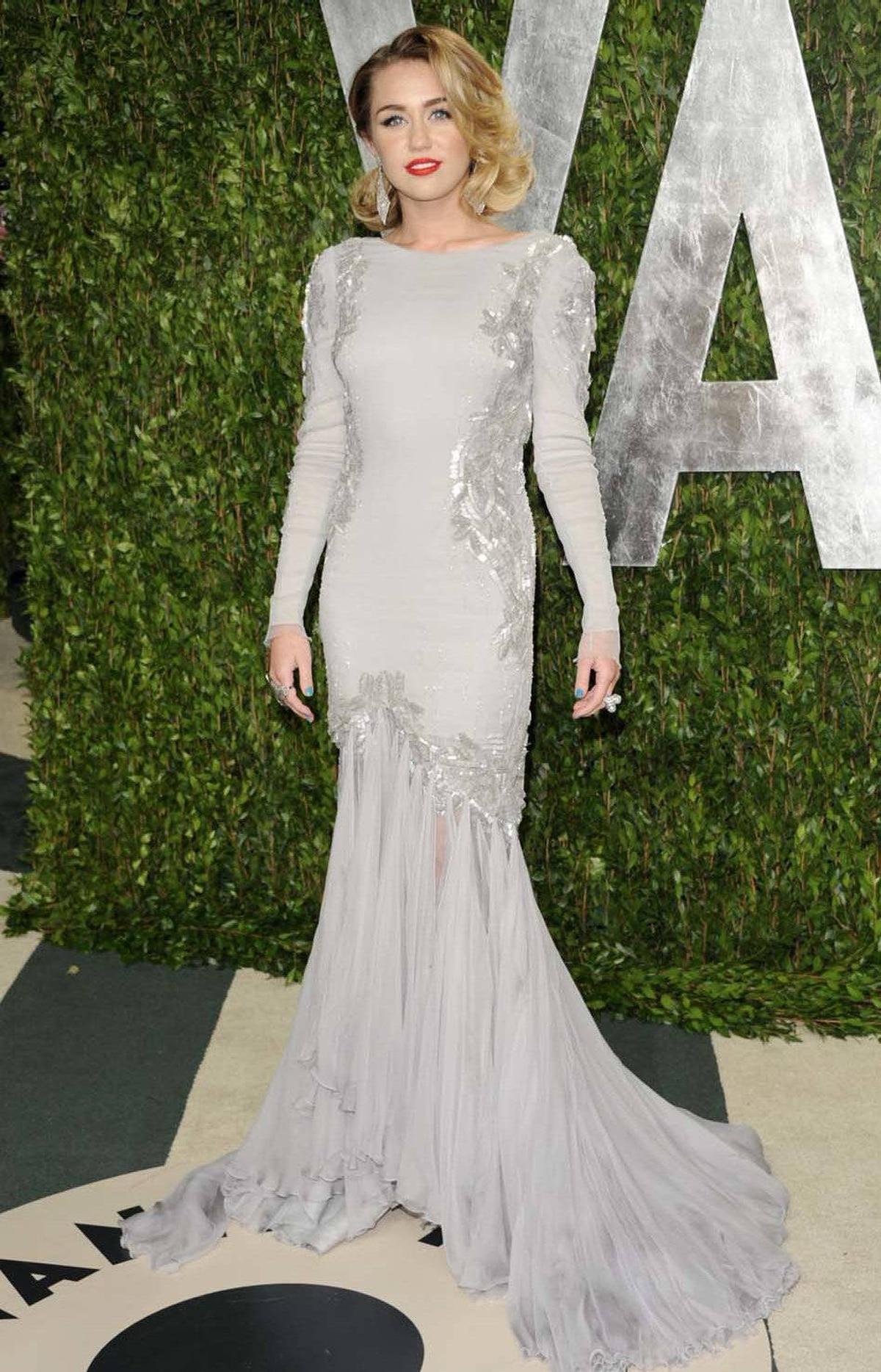 Miley Cyrus wore Roberto Cavalli to the Vanity Fair Oscar party on Sunday.