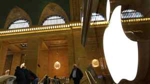 Customers visit the Apple Store in New York City's Grand Central Station January 25, 2012.