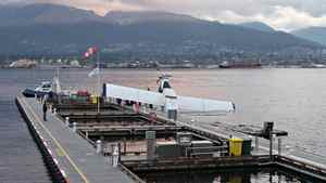 A plane, belonging to Harbour Air, lies partially submerged at the new dock facilities at the float plane terminal in Vancouver on November 5th, 2011.