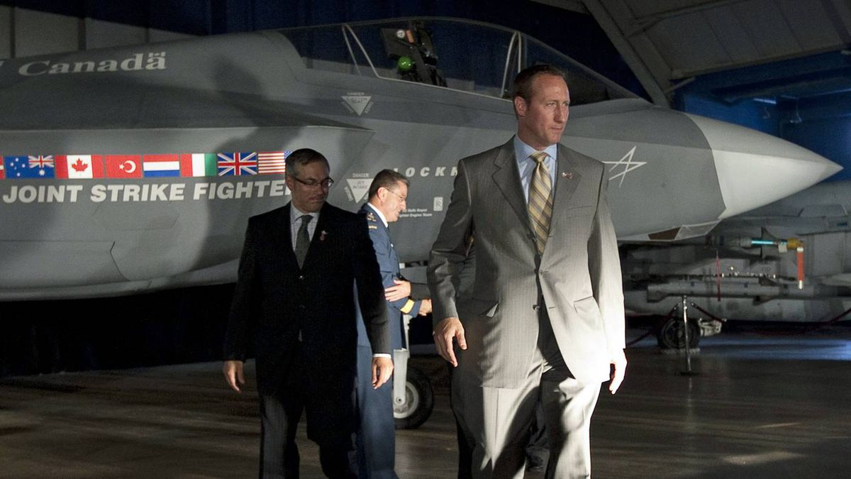 Defence Minister Peter MacKay and Industry Minister Tony Clement walk past a mock-up of the F-35 Joint Strike Fighter after announcing the Conservative government's plan to purchase 65 of the stealth jets in Ottawa on July 16, 2010.