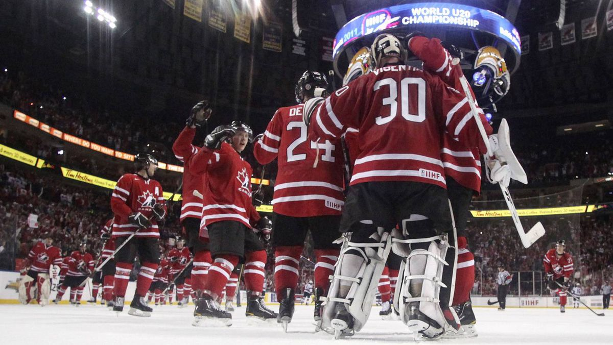 Members of Canada's hockey team celebrate after defeating the USA during their semi-final game at the IIHF World Junior Hockey Championships in Buffalo