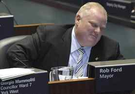 Mayor Rob Ford reacts to the vote on TTC Chair and Councillor, Karen Stintz's motion to return to the Transit City plan of the previous council at City Hall.