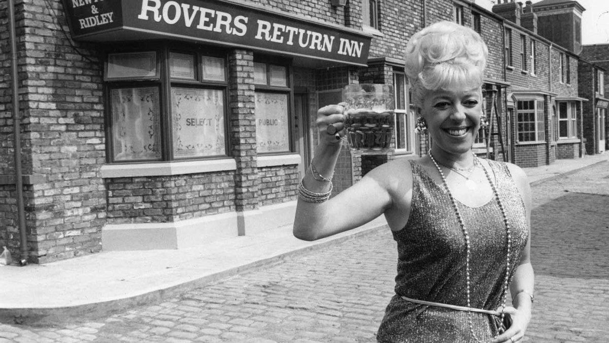 Julie Goodyear, who played barmaid Bet Lynch, outside the show's iconic pub, the Rovers Return Inn, in 1986.
