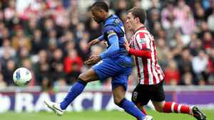 Manchester United's captain Patrice Evra, left, vies for the ball with Sunderland's Craig Gardner during their English Premier League soccer match at the Stadium of Light, Sunderland, England, Sunday, May 13, 2012.