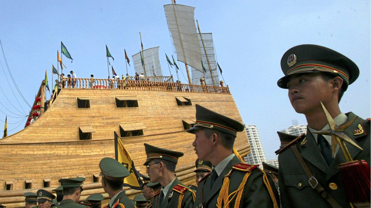 NANJING, CHINA - SEPTEMBER 23: Members of a military band wait to perform in front of the replica of the treasure ship sailed by Chinese navigator Zheng He (1371-1435), at the Zheng He Treasure Boat Factory Ruins Park launching ceremony on September 23, 2006 in Nanjing of Jiangsu Province, China.