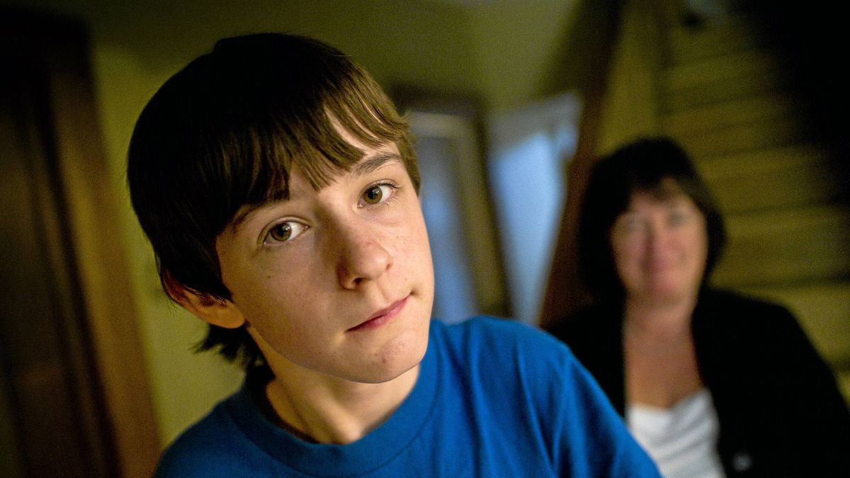Matthew Sheppard, 12, seen with his mother Cathy, suffers from dystonia, a movement disorder that interferes with his ability to perform daily tasks.