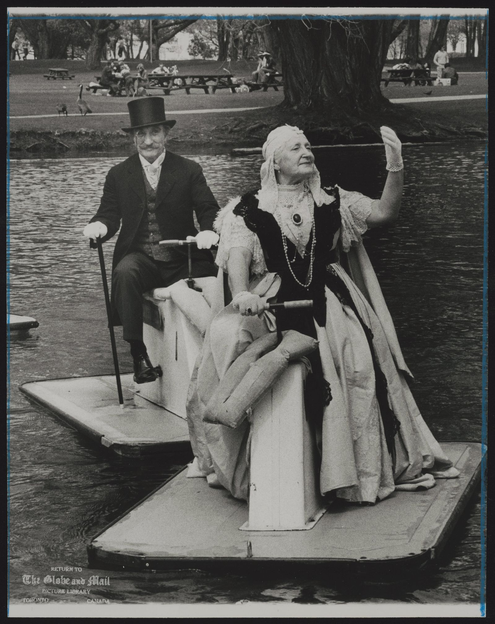 The notes transcribed from the back of this photograph are as follows: Queen Victoria and Prince Albert, played by Ann and Derrick Hart, arrive in Centreville.