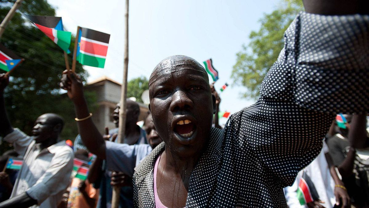 A southern Sudanese man celebrates during a march organised by the Sudan People's Liberation Movement (SPLM) in Juba on July 5, 2011, four days before South Sudan officially declares independence from the north.