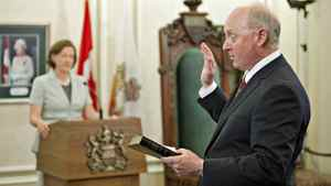 With Alberta Premier Alison Redford looking on, Ken Hughes in sworn in as Energy Minister at Government House in Edmonton on May 8, 2012.