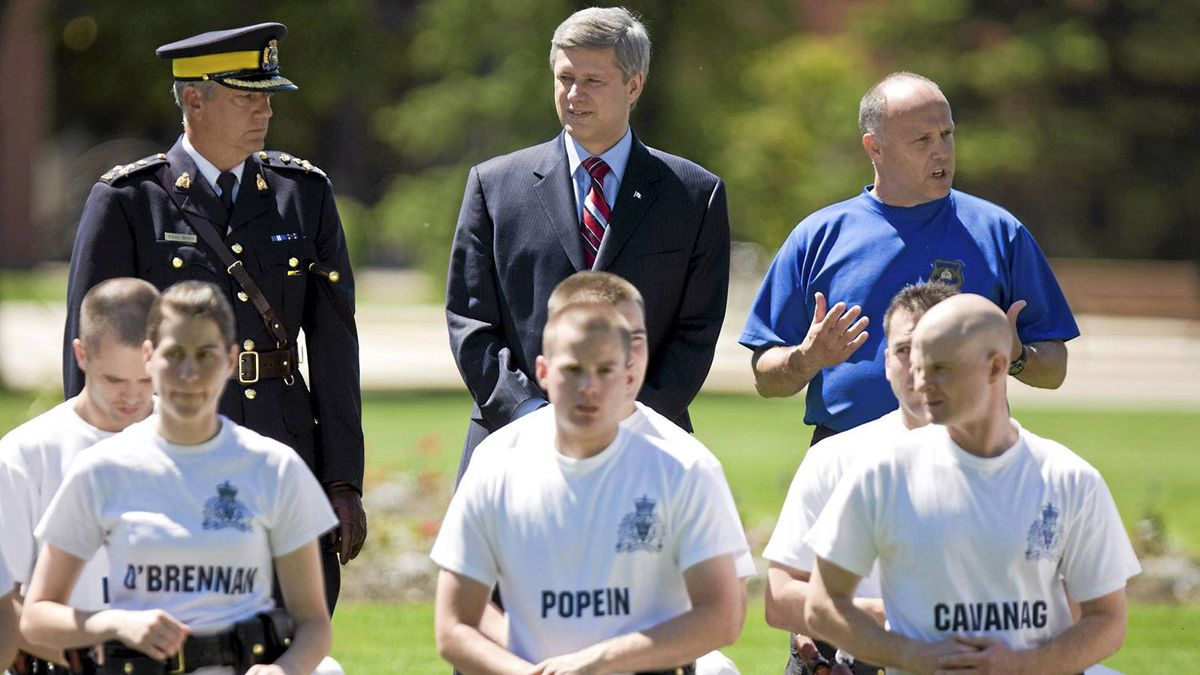 "Assistant Commissioner Roger L. Brown, Commanding Officer ""Depot"" Division, Prime Minister Stephen Harper and Police Defensive Tactics Unit Sgt. Ernie Brock (left to right) watch Cadet Troop 2 during a tactics class at the RCMP training depot on Friday, June 20, 2008 in Regina, Sask."