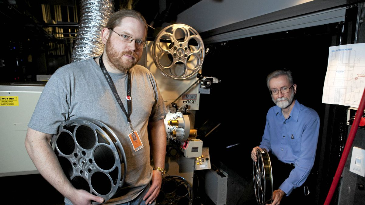 Projectionists Erik Kruka, left, and Dave Callaghan in a projection room at the TIFF Bell Lightbox