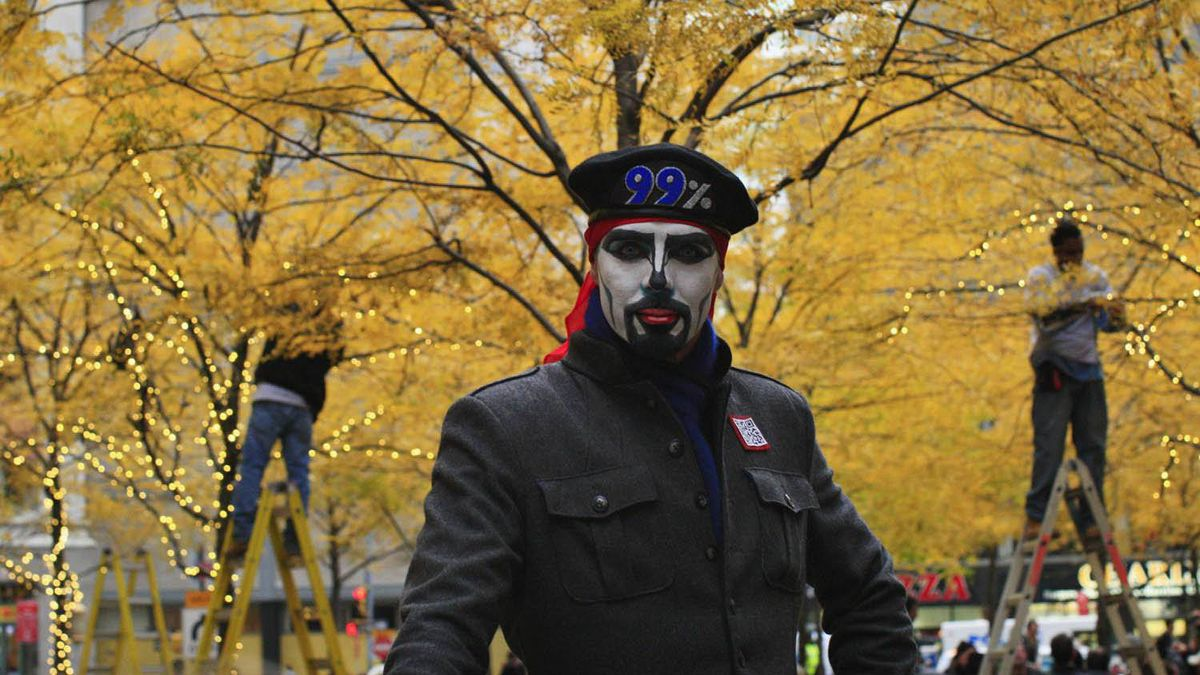 A protester affiliated with the Occupy Wall Street movement attends a daily meeting at Zuccotti Park in New York Nov. 19, 2011.