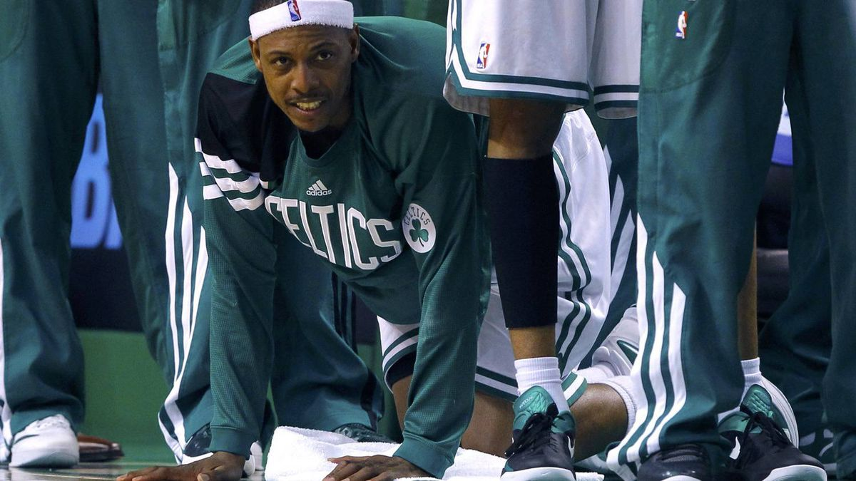 Boston Celtics' Paul Pierce cheers on his teammates after fouling out against the Philadelphia 76ers in the fourth quarter. REUTERS/Brian Snyder