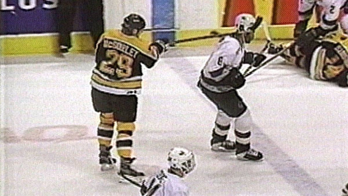 In this image from television, Boston Bruins Marty McSorley hits Vancouver Canuck Donald Brashear with a swinging slash to the right temple on Monday Feb 22, 2000 in Vancouver.