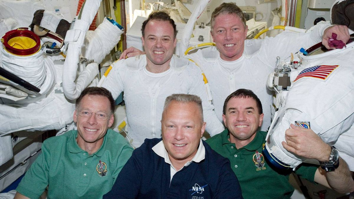 NASA astronauts Ron Garan (top left) and Mike Fossum (top right), from left front, NASA astronauts Chris Ferguson, STS-135 commander, Doug Hurley, pilot, and Rex Walheim, mission specialists pose for photographs in the Quest airlock of the International Space Station following a six-and-a-half-hour spacewalk July 12, 2011 in space.