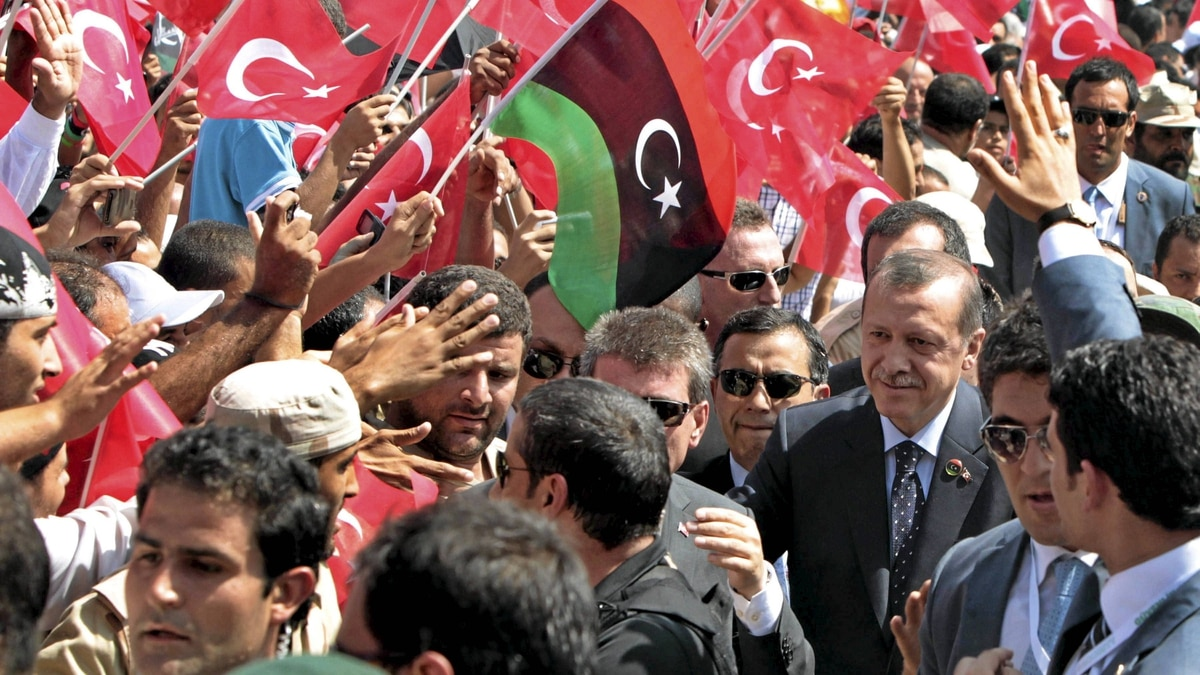Turkey's Prime Minister, Tayyip Erdogan, greets people upon his arrival at a rally in Tripoli on Sept. 16, 2011.