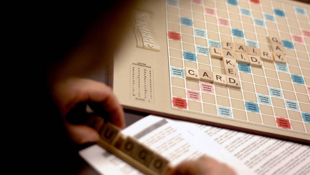 Author Margaret Atwood contemplates her next word as she participates in a Scrabble tournament to raise money for Performing Arts Lodges, which is an advocacy group for aging or ailing arts professionals.