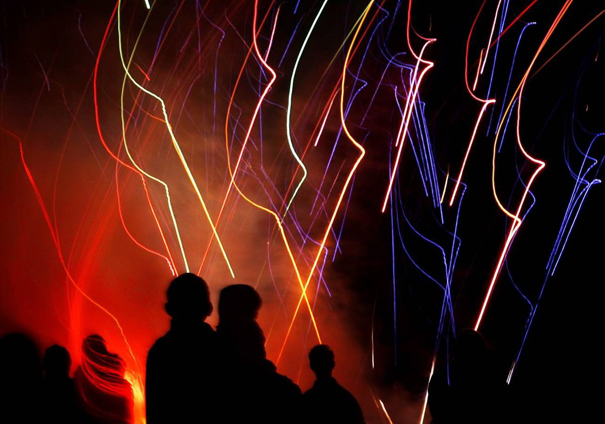 People watch fireworks during the Bonfire Night festivities in Lewes in southern England