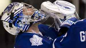 Toronto Maple Leafs goaltender James Reimer reacts at the final buzzer as his team beats Calgary Flames 3-2 in NHL hockey action in Toronto on Saturday October 15, 2011.