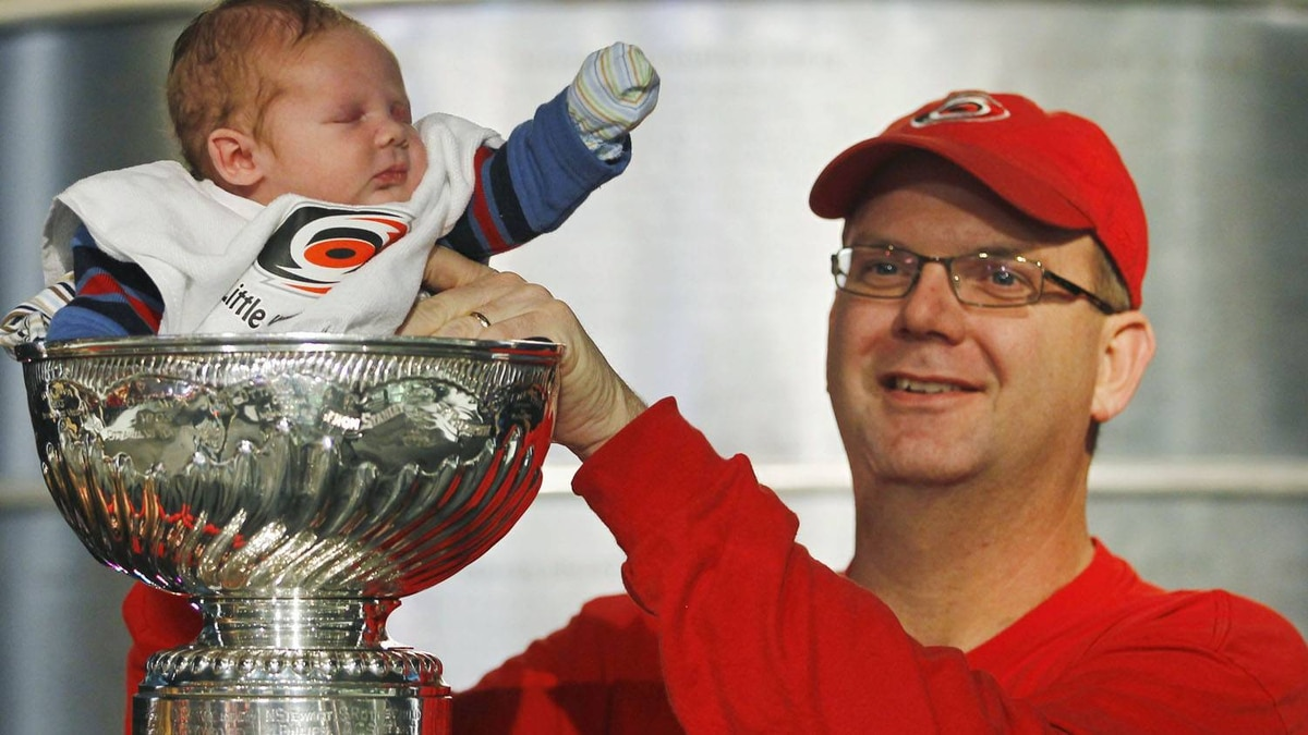 "Three-week-old Joshua Knowles sleeps as his father Andy places him in the Stanley Cup during the ""Fan Fair"" festivities as part of the NHL All-Star hockey weekend in Raleigh January 28, 2011. The All-Star game will be played on Sunday. REUTERS/Shaun Best"